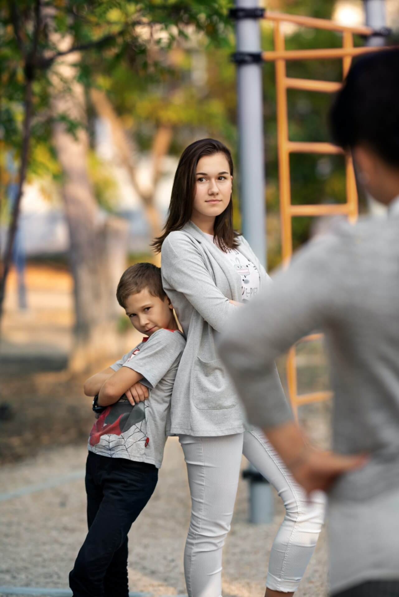 woman in white long sleeve shirt carrying child in white long sleeve shirt